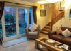 Lounge with french doors to enclosed courtyard