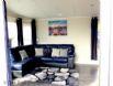 The Beach Hut - Comfortable corner sofa & cosy rug