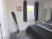 The Beach Hut - Main Bedroom showing mirror and clothes storage