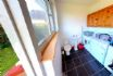 Utility room with loo, washing machine, dryer  and beach toys
