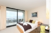 Floor to ceiling bedroom windows with an unbeatable view