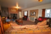 Large lounge with comfy seating & log burner