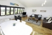 Large living/dining area with plasma screen television