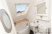 En suite with large corner bath and WC