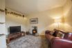 The Corner House - Lounge with wood burner